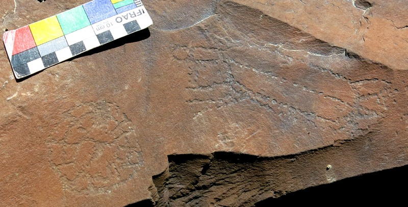 Fig. 14.50. Two geometric subjects, one round with a spoked pattern and one oval with radiating lines, which appear to have been engraved in the rock together. Protohistoric period.