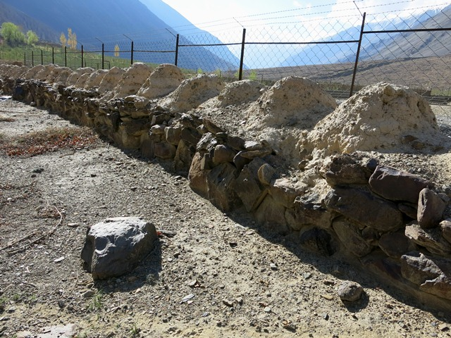 Fig. 18.1. Part of a long row of Buddhist chorten (mchod-rten) at Tabo. There are around 220 now highly eroded rounded structures (bum-pa) of earth in this construction. They rest upon a massively built stone base. Probably late 10th or 11th century CE.