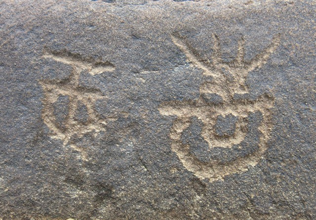 Fig.3. These two carvings are found on the opposite side of the boulder pictured in fig. 2.