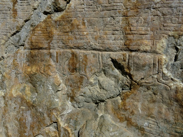 Fig. 21.10. The base of the large south chorten. Note the the line of lotus petals at the bottom of the carving. These petals are angular and elongated, another stylistic clue as to the age of the carvings at Jomo Phuk.