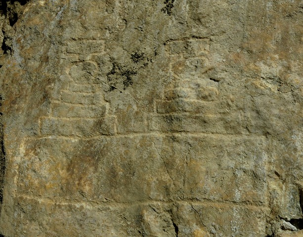 Fig. 21.13. Two spireless chorten sharing the same prominent base (20 cm in height). These are the southernmost carvings on the rock panel at Jomo Phuk.