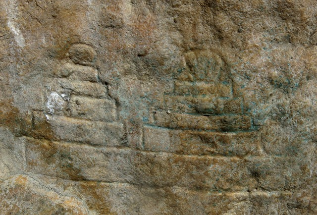 Fig. 21.14. Two chorten below the large south specimen. They are each 5 cm in height. These are the lowest carvings on the rock panel.
