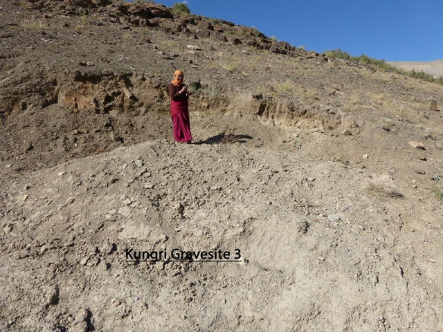Fig. 24. Nun posing at site of partially excavated tomb, Gungri. Photo courtesy of SRAHS.