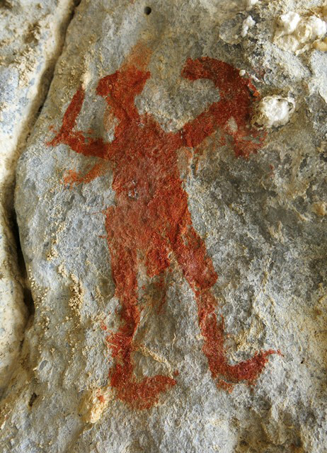 Fig. 27.10. Close-up of anthropomorph (17 cm high) in fig. 27.3. This figure brandishes what looks like a shield and sword and appears to have male genitalia. Any depiction of weapons might be directly relatable to accounts in Tibetan literature of pre-Buddhist priests (bon and gshen) and there warlike activities. As already mentioned, much of the anthropomorphic rock art of Spiti is unambiguously marked as male.
