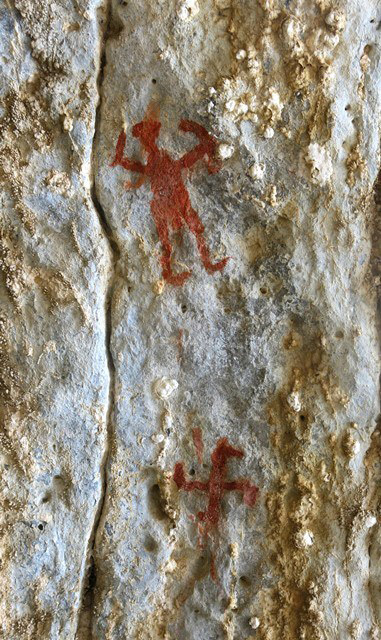Fig. 27.3. An adjacent part of the north wall of Nyima Loksa Phuk, with anthropomorph and swastika. These two pictographs may possibly have been painted at the same time.