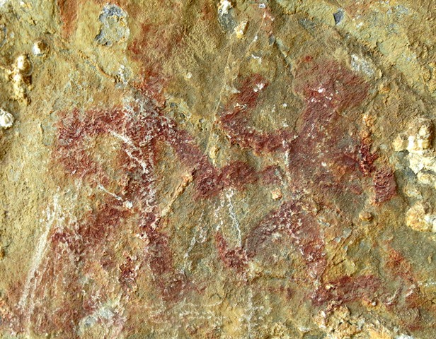 Fig. 28.9. A composition consisting of a pair of anthropomorphic figures (around 9 cm high) located in middle of the cave wall pictured in fig. 28.3. Their arms and legs swing wide, suggesting that these figures are dancing or engaged in some other kind coordinated behavior suggestive of ritualism.