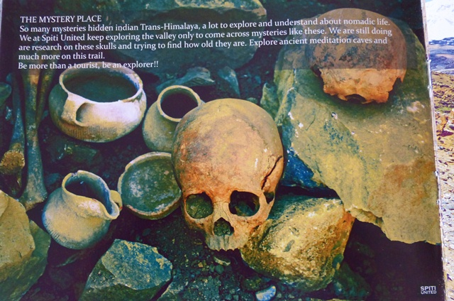 Fig. 41. Ceramic vessels and human skulls removed from the tomb at Tashigang and used as promotional materials for a tour company called Spiti United. Note the cord-marked vessel with spout and handle on the lower left side of the photograph.
