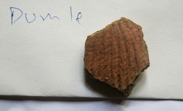 Fig. 52. A single fragment of a cord-marked redware vessel of the type deposited in tombs in Spiti. This ceramic sherd came from the settlement of Dumle.
