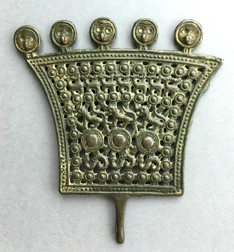 Fig. 3. Fan-shaped openwork animal style thokcha (13 cm in height), Tibet. The three rows of animals in profile (from bottom to top) are snakes (3), tigers (3) and antelope / ibex (7). On the top of the object is a series of round bird heads. Private collection. Probably Iron Age.