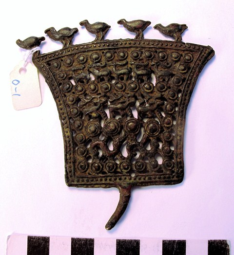 Fig. 5. Fan-shaped openwork animal style thokcha, Tibet. The animals shown in profile on this object are (from bottom to top) snakes (2 examples), stags (3), antelope / ibex (5), birds (6). Probably Iron Age. Collection of Moke Mokotoff, New York.