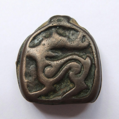 Fig. 7. Small Tibetan thokcha embossed with stag in the Eurasian animal style (2.2 cm x 2.2 cm). Iron Age or Protohistoric period. Carol Yong collection, Hong Kong. Photo courtesy of Carol Yong.
