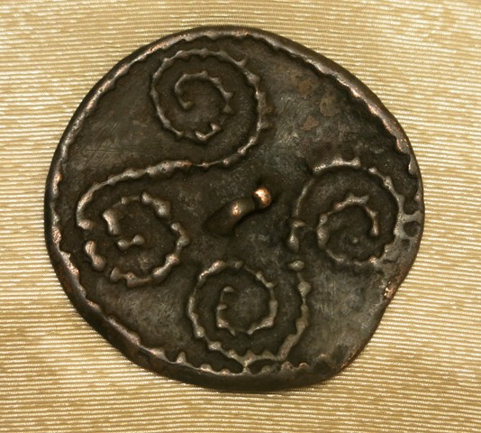 Fig. 11. A disc-shaped thokcha with a pair of nubbed scrolls and thin attachment loop in the middle (approximately 70 cm in diameter) of the object. The rim of the object is similarly nubbed. This object is probably from the Tibetan plateau. Late Bronze Age or Iron Age. Amdo Tsegyal (A-mdo tshe-rgyal) collection, Amdo.
