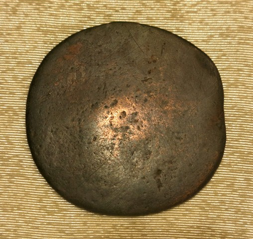 Fig. 12. The reverse of the thokcha in fig. 11. This undecorated face of the object is slightly curved.