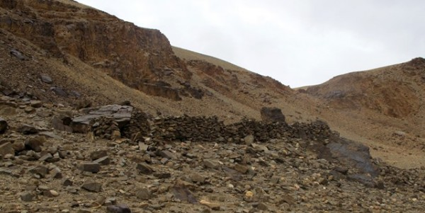 Fig. 1. The site of Rock Art Village in Guge, western Tibet. Most of the walls visible in the image were reconstructed for use as a livestock corrals. The rim of the esplanade is just behind the ridges enclosing the site.