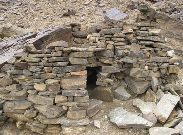 Fig. 6. The partially intact chamber in the middle tier of Rock Art Village. Note the random-rubble wall fabric and lack of mortar. This may originally have been a dry-wall structure but it is too degraded to know for certain. This tiny room constituted a small part of the middle tier structures, the forward portions of which are entirely obliterated.
