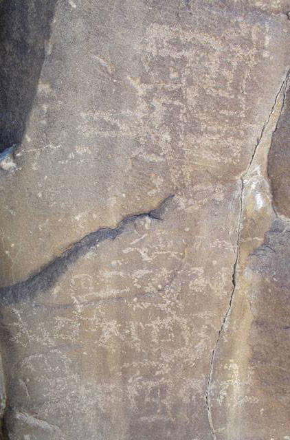 "Fig. 49. Large counterclockwise swastika and what appears to be an incomplete swastika carved above an inscription reading: Khyung pho ma…bris (""Written by Khyung pho…""), northwestern Tibet."