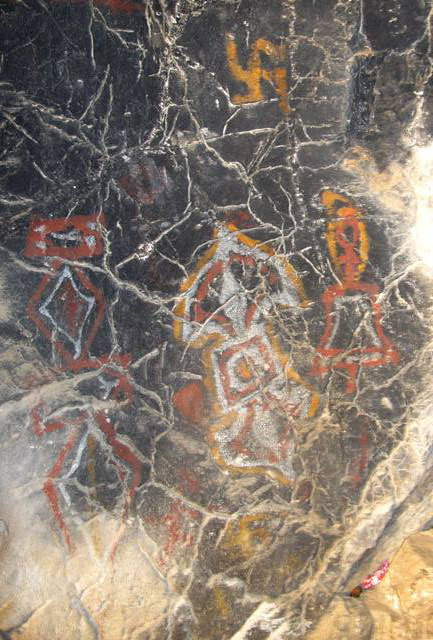 Fig. 63. Polychrome rock art consisting of clockwise swastika, ritual dagger (phur pa), ritual thunderbolt and bell (dril bu). Central Changthang. Probably Vestigial period.