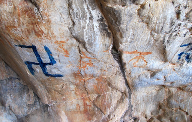 Fig. 84. Recently painted counterclockwise swastika obscuring earlier rock art, eastern Changthang.