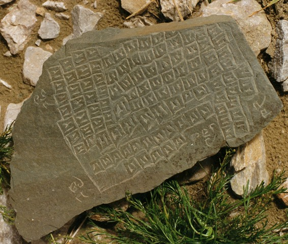 Fig. 5. A stone plaque featuring the 108 kha syllables and the names of the four warrior spirits, complete with spelling mistakes. The mantra of 14 syllables is not included on this plaque. Tshochen/Gertse.
