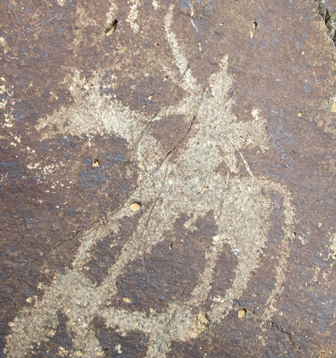 Fig. 24: Figure on horse brandishing a bow with what may be a quiver on his back. Protohistoric period.