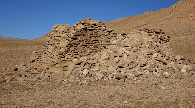 Fig. 36. The east and south walls of the temple-tomb, Central Complex. The rubble piled against the structure came from the destroyed portion of the east wall and the interior of the edifice.
