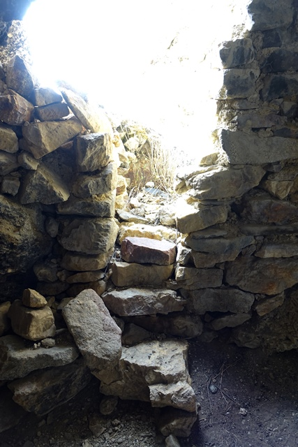 Fig. 16. Entrance and façade of cave on edge of the bench seen from the interior.