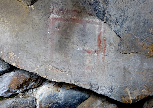 Fig. 17. Bichrome pictograph painted on rear wall of cave on the edge of the bench. This subject consists of a rectangular form, the bottom part of which has been largely obliterated. It is subdivided into at least five quadrate sections. The red lines of this pictograph are paralleled inside and out by thinner white lines.