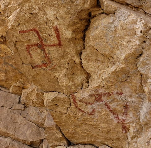 Fig. 31. A close-up of the letter A and swastika on the wall of the formation.