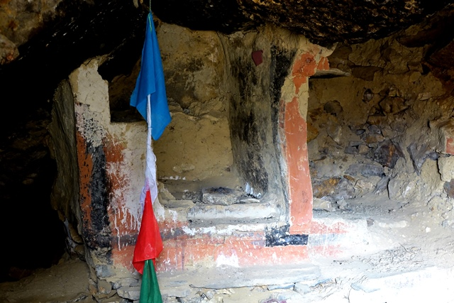 Fig. 40. A stone and adobe ambry in rear of the larger cave of the middle tier, upper residential complex. This structure was painted with three different colored pigments. To the right is an alcove.