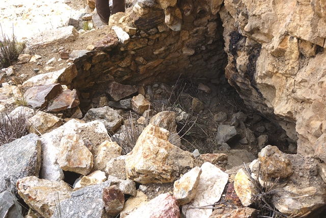 Fig. 44. Room built in a recess in the formation, lower tier. The remains of corbelling that once encircled the top of the walls are visible.